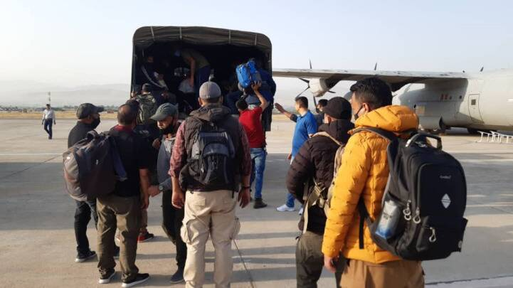 Indians wait to board a military transport aircraft of the Indian Air Force in Kabul on Saturday. (Photo by Twitter/@MEAIndia)