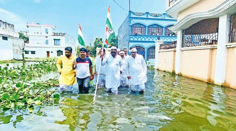 """Ajay Kumar Lallu tweeted a video on Saturday, which he claimed was shot in Gorakhpur's Singhadia area where """"there is waterlogging for more than 45 days"""". """"There has been major corruption in the construction of the drains in the area. If this is the situation in the chief minister's city, then one can understand the situation in other places,"""" added Lallu. (Source: Twitter)"""